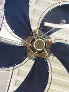 The Raindance Nautical Ceiling Fan. Don't forget that you can customize it by motor and canvas finish! (Antique Bronze motor with green canvas blades, Oil Rubbed Bronze motor with white canvas blades... the possibilities are endless considering you can also add a light, remotes, and have a longer extension!  http://www.tropicalfancompany.com/nautical-ceiling-fans-index.aspx