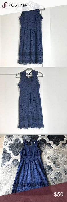 J. Crew Navy Eyelet Ruffle Sun Dress 4P Perfect summer dress featuring on-trend ruffles and eyelet. Size 4 petite. Cotton dress with silk lining. Hidden zip in the back with keyhole back and tie at the neck. Excellent pre-owned condition. Offers welcome, no trades. J. Crew Dresses