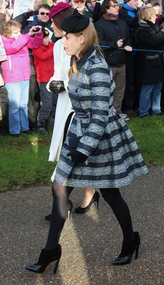 Princess Beatrice and Princess Eugenie attend Christmas Day Service at Sandringham Church on December 25, 2014 in King's Lynn, England.