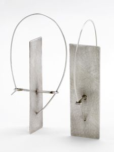 Solitary Plane Earrings: Sarah Mann: Silver Earrings | Artful Home. This earwire is insane but creative.