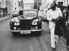 Marvin Gaye strolling ahead of his Rolls Royce in Notting Hill, London, in 1976. Photo: John Minihan/Getty.