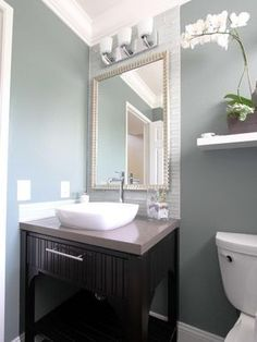In this soothing blue-gray and white contemporary bathroom, small details add visual texture, such as the framed mirror, the white glass-tile backsplash, the vessel sink and the textured dark wood vanity. Guest Bathrooms, Small Bathroom, Bathroom Ideas, Modern Bathrooms, Guest Bathroom Colors, Vanity Bathroom, Downstairs Bathroom, Bathroom Cabinets, Blue Bathrooms