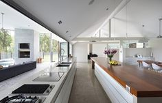 massive wide bifold window opens up this kitchen area to its outside entertaining space