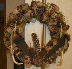 patterned burlap wreath with deer antlers, wild turkey feathers, pine cones & acorns. Hunting Wreath, Antler Wreath, Feather Wreath, Feather Crafts, Diy Fall Wreath, Wreath Ideas, Shotgun Shell Crafts, Antler Crafts, Rustic Wreaths