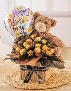 An edible arrangement filled with Ferrero Rocher and Beyers Chocolate Stars. The perfect gift to say Happy Birthday with!