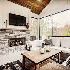 This is the perfect spot to settle in and get cozy this Christmas 🔥❄🎄 I love this shot from one of our Modern Farmhouse designs this fall.   @celebritybuildersllc    #interiordesign #interiordesigngrandrapids #blackandwhite #cozy #barnwood #cvidesign #porch #sunroom #lanai #customhomebuilder #fireplace #fireplacegoals