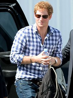 Prince Harry jet-setted in shady style! Gotta love his sleek rectangular sunnies with an aviator-inspired bridge!