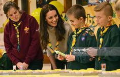 Britain's Catherine, Duchess of Cambridge (2L), ices cupcakes during a Cub Scout Pack meeting with cubs from the Kings Lynn District, in Kings Lynn, eastern England, on December 14, 2016, to celebrate 100 years of Cubs.The Duchess attended a special Cub Scout Pack meeting with Cubs from the Kings Lynn District to celebrate 100 years of Cubs. Cub Scouting was co-founded by Robert Baden-Powell and Vera Barclay on the 16th December 1916. / AFP / POOL / BEN STANSALL        (Photo credit should…