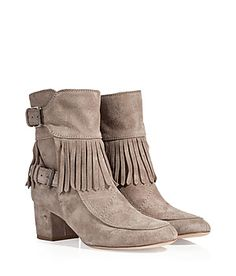 Step up your look with a kick of Parisian cool in Laurence Dacade's fringed leather boots #Stylebop