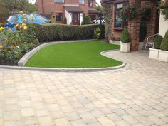 Driveways create parking and access, but can also be designed to fit in as part of the garden landscaping scheme, lifting the appearance of the front of the Garden Slabs, Garden Blocks, Garden Paving, Garden Paths, Front Driveway Ideas, Driveway Design, Driveway Landscaping, Landscaping Design, Block Paving Driveway