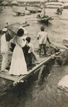 CROSSING THE RIVER USING CARABAO CART [1919] via Pearl of the Orient: Discover Philippines