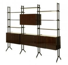 A Mid-century Iron And Formica Bookcase
