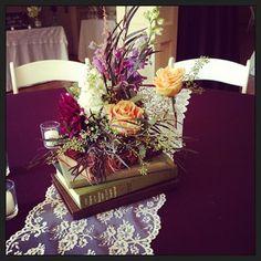 vintage centerpiece | book centerpiece | fall centerpiece | purple and peach centerpiece | lace runner | plum and orange wedding flowers