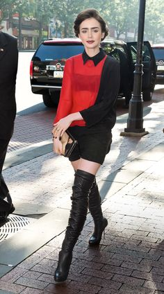 The right mix: A conservative Maxime Simoens collared shirt offsets the sexiness of Collins' thigh-high Louboutin boots.