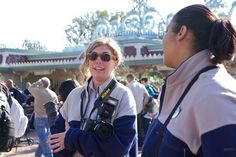 Photopass photographers will take free photos of you with your camera if you ask them too. | 35 Insider Hacks For Taking Your Kids To Disneyland