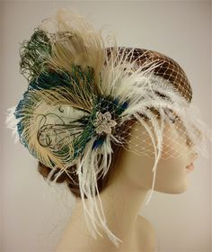 Bridal feather fascinator with bandeau veil