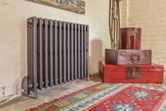 The Etonian electric cast iron radiator has been installed in various National Trust properties. Electric Radiators, Cast Iron Radiators, Central Heating Radiators, Column Radiators, Towel Radiator, Steel Columns, Column Design, Ral Colours, Grand Designs