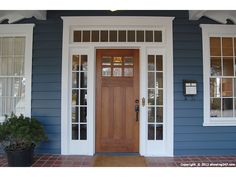 Craftsman front door >> Would love to do this with the windows, would totally change the facade of my home!