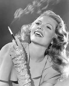 Rita, prob late 1940's. Love the clock-stopping beauty of course, but also the Dunhill cigarette holder.  She likely had a few of these between her and Orson Welles. Beauty and class from a by-gone era.