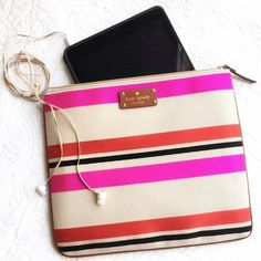 Kate Spade Adrianne Oak Island Pouch Multi color striped canvas like pouch.  Beige with pink and red stripes and lined inside with pockets inside.  Zipper closure. Perfect for iPad, accessories, cosmetics or even as a clutch.  Brand new with tags! kate spade Accessories Tablet Cases