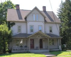 The two-family house at 187-189 Main Street in Unionville (in Farmington) was built around 1885 as a rental house by Minerva Upson Frisbie, wife of Samuel Frisbie, a treasurer of the Upson Nut Company (he also had a number of patents for machines). The house is trimmed with decorative features in the Stick style, such as sunbursts.
