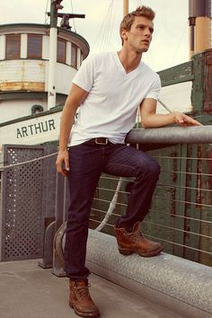 Shop this look on Lookastic:  https://lookastic.com/men/looks/white-v-neck-t-shirt-navy-skinny-jeans-dark-brown-boots-dark-brown-belt/13070  — White V-neck T-shirt  — Dark Brown Leather Belt  — Navy Skinny Jeans  — Dark Brown Leather Boots