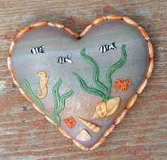 """Sea Life"" Made by me in 2007...This is a polymer clay heart that measures 1.5""x1.5"". It is entirely crafted of polymer clay. No paints or any other medium incorporated into it."