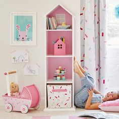 A pretty bookcase for children's bedrooms designed in the shape of a house.