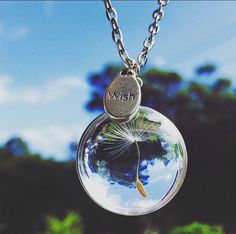 Dandelion 'Wish' Necklace. Found these beautiful necklaces and charms for sale on this website. A truly inspirational gift my 8yr daughter will love.