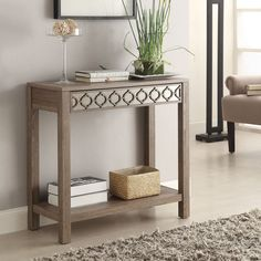 A simple and classic sun-bleached driftwood style finish and ogee mirrored inlay create a stunningly quaint look. This transitional piece is made of eco-friendly engineered wood to keep your home and your planet looking good.