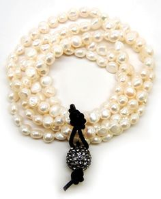 Once Upon A Time - elegant stretchy multi-strand white cultured pearl bracelet.