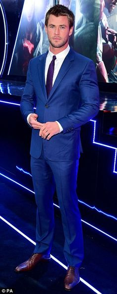 A treat for the ladies: Chris Hemsworth looked suitably handsome in a blue suit and brown ...