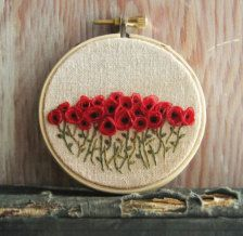 Red Poppy Field Hand Embroidered Wall Decoration    3 inch hoop - see the last photo for size reference    A field of bright red poppies made with ribbons and hand embroidery. Done on natural tea dyed linen secured in a 3 inch hoop that has been sealed to keep a natural finish. Backed with white felt for a more finished look.    Thank you for stopping by,    Lynn    You can find more of my listings here: http://www.sidereal.etsy.com