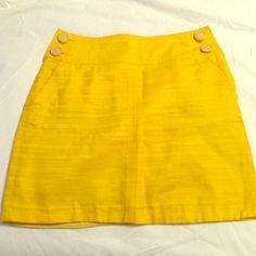 Bright yellow Banana Republic mini skirt Sunny bright yellow mini skirt with button details and pockets. Slightly worn, but in fantastic condition. The perfect summer skirt! Banana Republic Skirts Mini