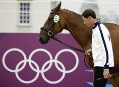Will Coleman of the United States and his horse Twizzle walk through a horse inspection for the equestrian eventing competition at the 2012 Summer Olympics July 27.