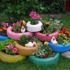 Old tires painted appealing colors and stacked to use for flower planters