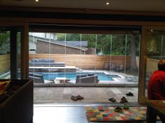 """Toronto here's something to take your mind off of this winter's deep freeze! This is a gorgeous """"open"""" Amberwood Panoramic TM Lift & Slide Door System! It showcases this pool beautifully! Custom Wood Doors, Deep Freeze, Folding Doors, Door Opener, Summer Sale, Home Renovation, Craftsman, Toronto, Accordion Doors"""