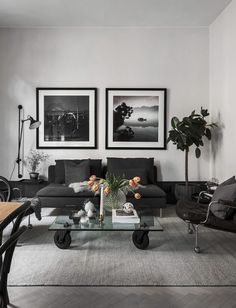 Stylish home with a dramatic touch - via Coco Lapine Design.Are you looking for unique and beautiful art photo prints to create your gallery walls? Visit bx3foto.etsy.com and follow us on IG @bx3foto