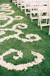 Beautiful wedding aisle rose petal design idea.