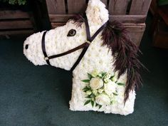 Our white horse with his dark brown mane, is a wonderful tribute for any one who loves horses.