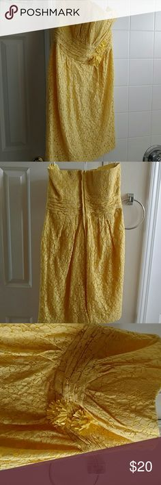 """Yellow strapless dress Straight from dry cleaners. Strapless dress, sheath fit, sweetheart neck line, small slit in back, back zipper, waist banding and detail. The overlay is heavy lace, with a solid yellow underlay. Approx 30"""" side seam, top to bottom. It has been worn 2-3 weddings.  Has a little dark mark on the back at the top of the dress. Easily covered with any type of vest, Jean jacket or cardigan. David's Bridal Dresses Midi"""