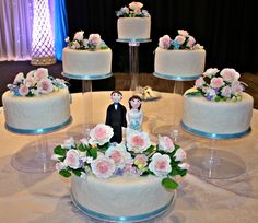 My first wedding cakes.  The bride wants her cakes presented exactly this way, not the traditional tiered-types.
