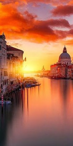 The sun sets on the Baroque-style skyline of Venice, Italy.