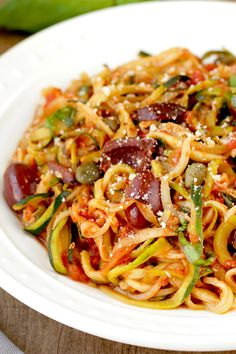 Zucchini-noodle recipe! Spaghetti puttanesca is packed with flavor. (Olives! Anchovies!) But it doesn't have to be packed with carbs, thanks to this zucchini-noodle swap! 1/2 recipe: 193 calories | 8g fat | 23g carbs | 3 Weight Watchers SmartPoints | PIN!