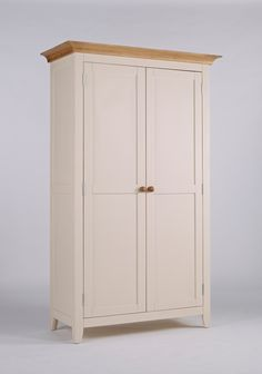 New England Painted Full Hanging Wardrobe This is a beautiful wardrobe  Clean fresh lines and lightly painted in ivory  It has full hanging space for even long dresses The doors have gorgeous detailing around the edges With lovely hinges The top is solid ash that has been lightly lacquered This is a satin finish which is resilient and serves to protect the natural beauty of the ash The frames are solid pine With high quality MDF panelling Finished in a knock resistant paint in ivory