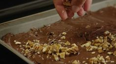 Get the recipe @ http://allrecipes.com/recipe/saltine-toffee-cookies/detail.aspx Watch how to turn saltine crackers into what will become one of your family'...