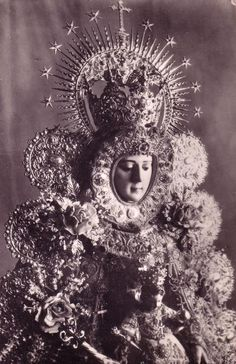 Nuestra Señora del Rocío  The Virgin ofEl Rocío in Almonte, Spain.  The annual procession and pilgrimage to the shrine, known as the Romería de El Rocío, draws about a million devotees each year.
