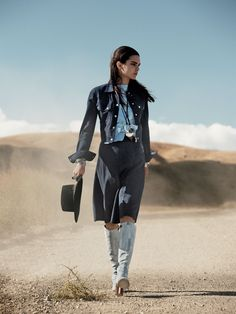Lone Ranger - Looking for a denim-on-denim upgrade? Swap out your blue-jean separates with buttery-soft indigo suede. Michael Kors jacket and skirt. Loewe napa-leather top. Saint Laurent by Hedi Slimane bracelets. Louis Vuitton boots.