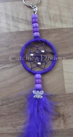 Purple Dream Catcher with Angel Wings | ... available dream catchers feather drop butterfli charm purpl dream