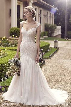 Freesia's breathtaking fit-n-flare silhouette has a bodice with light ruching…